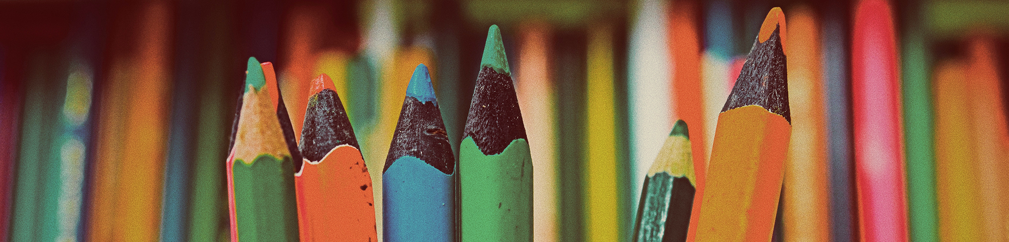 Decorative banner image of colored pencils.